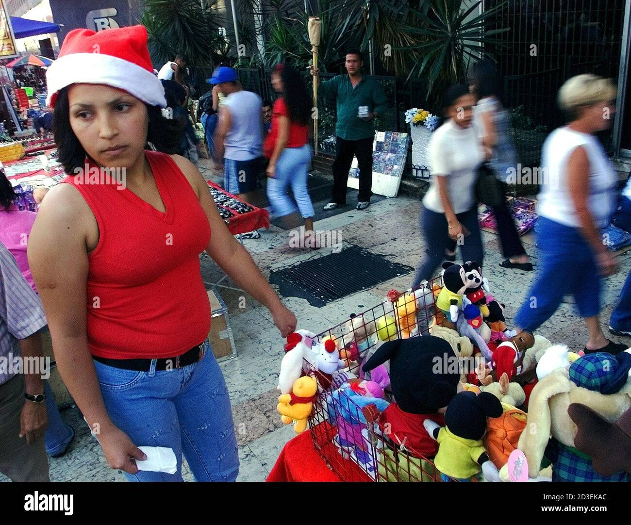 Elizabeth Daza, 20, sells puppets on the street in Caracas, December 23, 2002. Venezuelan President Hugo Chavez's government on Monday proposed a Christmas truce to foes as the nation steeled itself for a holiday marred by an opposition strike that has crippled the oil industry and disrupted gasoline and food supplies. REUTERS/Jorge Silva  JS Stock Photo