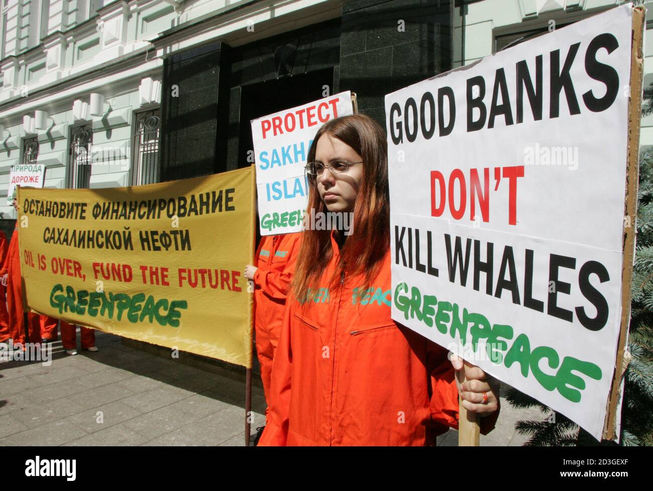 Greenpeace activists protest against Credit Swiss banks financing of the expansion of Shells liquefied natural gas plant on Russias Sakhalin island in front of the banks Moscow office.  Greenpeace activists protest against Credit Swiss bank's financing of the expansion of Shell's liquefied natural gas plant on Russia's Sakhalin island in front of the bank's Moscow office, June 27, 2005. Intentions for the expansion project were announced earlier this month by oil major Royal Dutch/Shell. REUTERS/Sergei Karpukhin Stock Photo