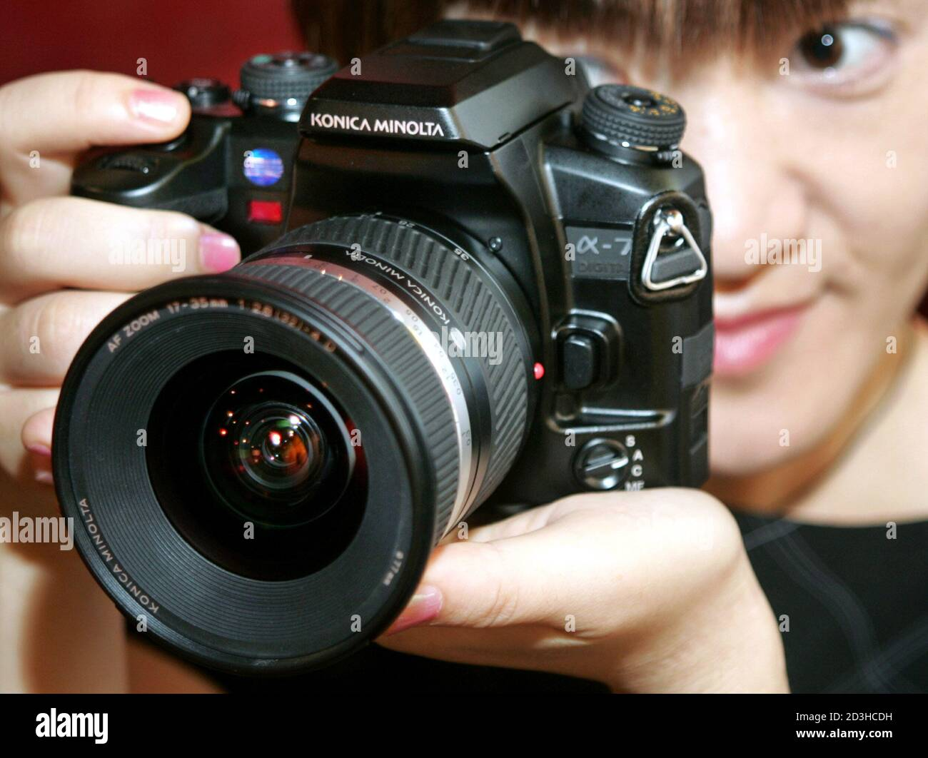 Japanese precision equipment maker Konica Minolta Holdings Inc. unveils its new digital single-lens reflex (SLR) camera 'Alpha-7 Digital' in Tokyo September 15, 2004. The camera with interchangable lenses is the world's first product equipped with technology which stabilizes image by shifting the CCD sensor inside the body to compensate for camera movements, the company said. Stock Photo