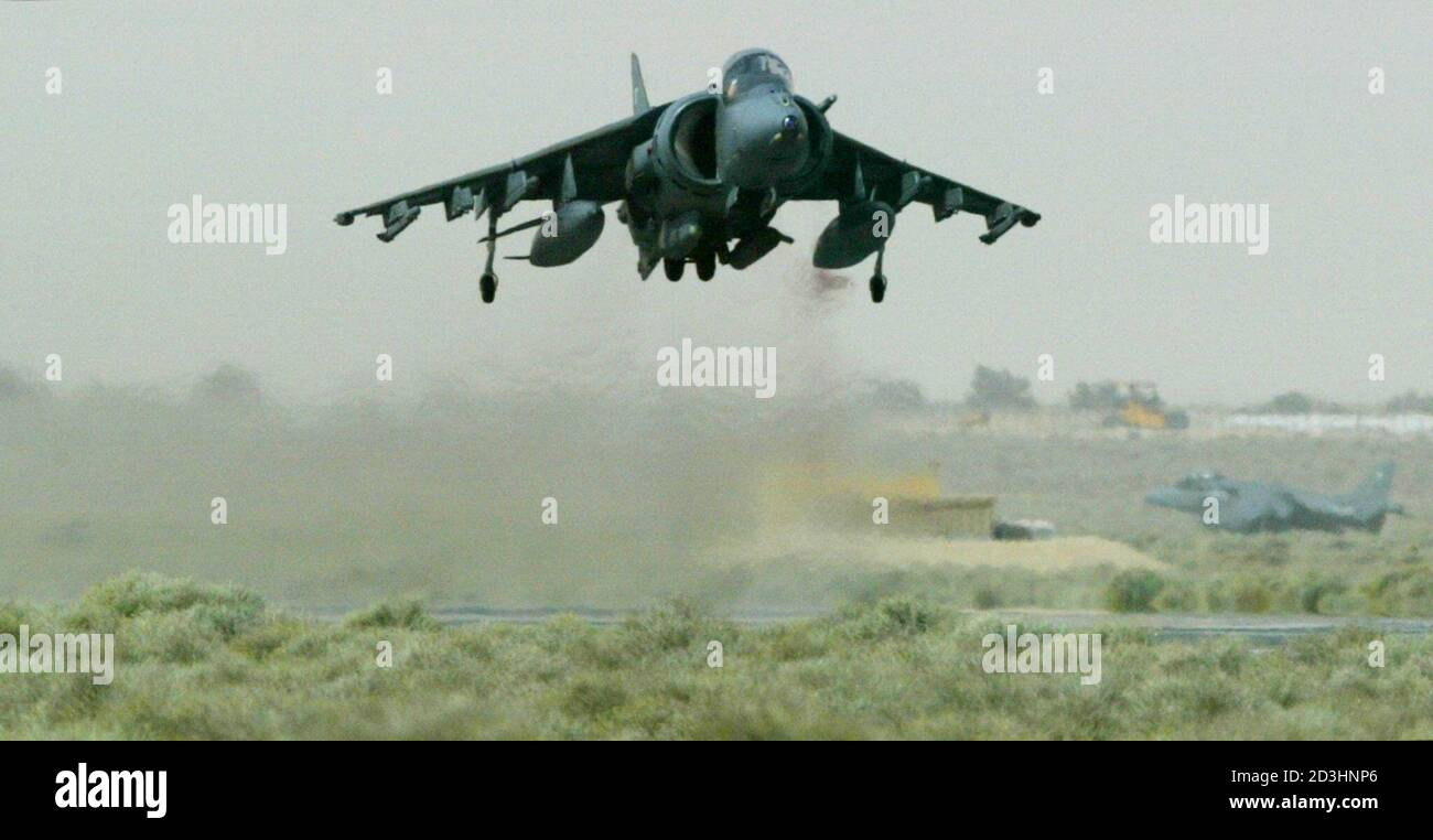 A Royal Air Force Harrier GR7 ground attack jet of the 2nd/4th Wing RAF Cottesmore lifts off from a base in the Gulf, on its way to a training mission March 4, 2003. Britain's Chancellor of the Exchequer Gordon Brown pledged on Tuesday that the government would find all the necessary money to fund a possible war with Iraq and the battle against international terrorism. The British finance minister has already set aside 1.75 billion pounds ($2.76 billion) to cover the cost of any conflict, which could start within weeks.  REUTERS/Chris Helgren Stock Photo
