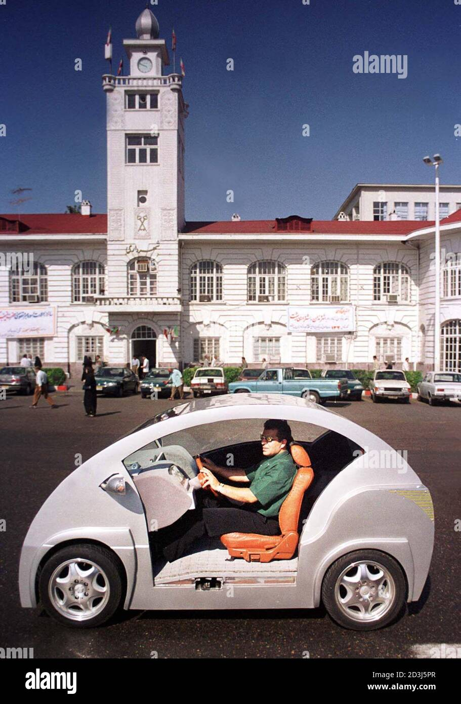 Iranian Engineer Gamshid Arian Drives The First Iranian Electric Car Aryana 792 In The Northern Iranian City Of Rasht July 18 2002 Arian Designed And Built The Four Seater Car Complete With A
