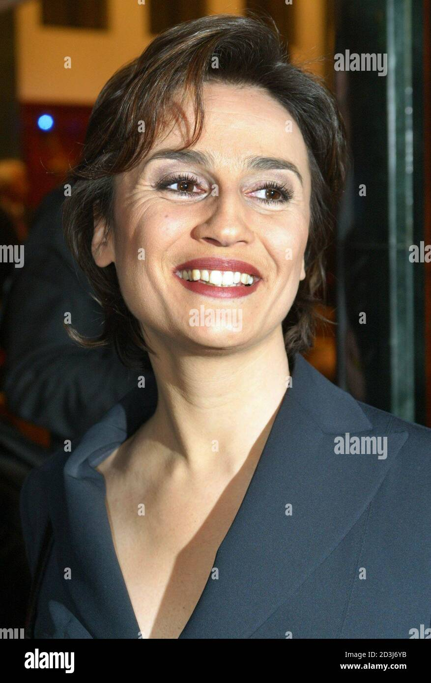 Sandra Maischberger, German television presenter of NTV broadcasting station smiles during a reception in the German capital Berlin January 20, 2003. Maischberger attends a celebration for the 65th birthday of Paul Spiegel, president of the German Jew Council. REUTERS/Fabrizio Bensch  FAB Stock Photo