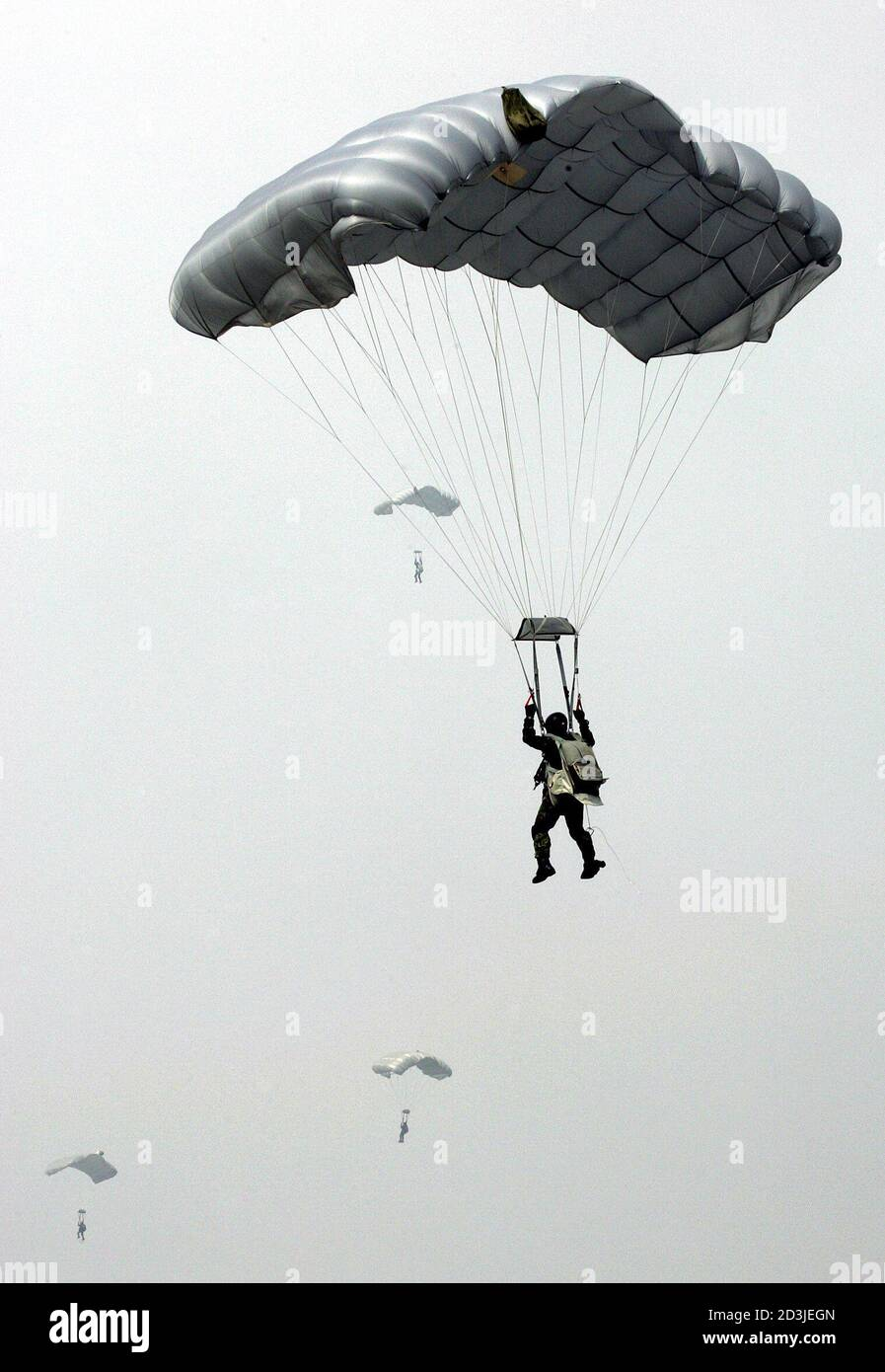 "A parachutist prepares to land during an anti-airborne military exercise at the CCK air base in Taichung, central Taiwan, July 27, 2005. The military exercise, involving simulated repulsion of airborne assaults on an airbase, is part of Taiwan's annual ""Han Kuang"", or Chinese Glory, exercises aimed at testing the military's readiness against a Chinese invasion. Taiwan President Chen Shui-bian warned on Tuesday that arch-rival China's growing missile build-up not only posed a threat to his democratic island, but also endangered the world. REUTERS/Richard Chung  AH/PN Stock Photo"