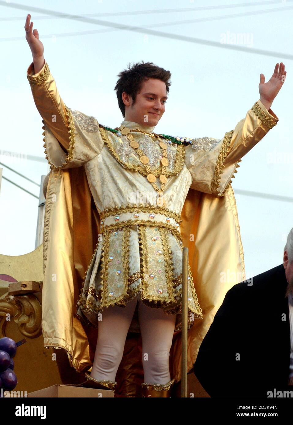 Actor Elijah Wood reigns as Bacchus XXXVI during the Krewe of Bacchus Parade in Uptown New Orleans February 22, 2004. Fat Tuesday is February 24. REUTERS/David Rae Morris  DRM/JDP Stock Photo