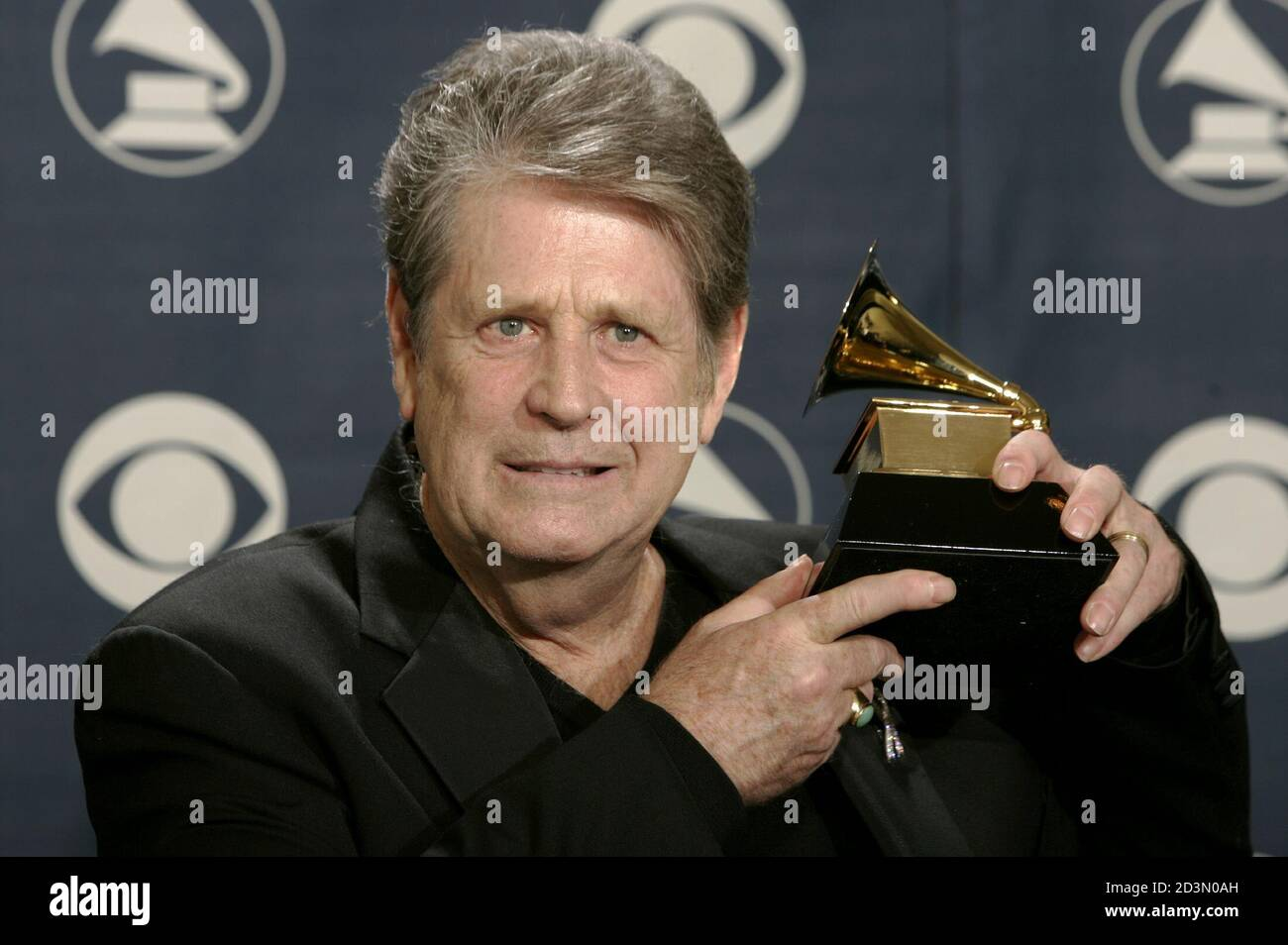 """Former Beach Boy Brian Wilson holds his award backstage at the 47th annual Grammy Awards at the Staples Center in Los Angeles February 13, 2005. Wilson won for Best Rock Instrumental Performance for """"Mrs. O'Leary's Cow. Stock Photo"""