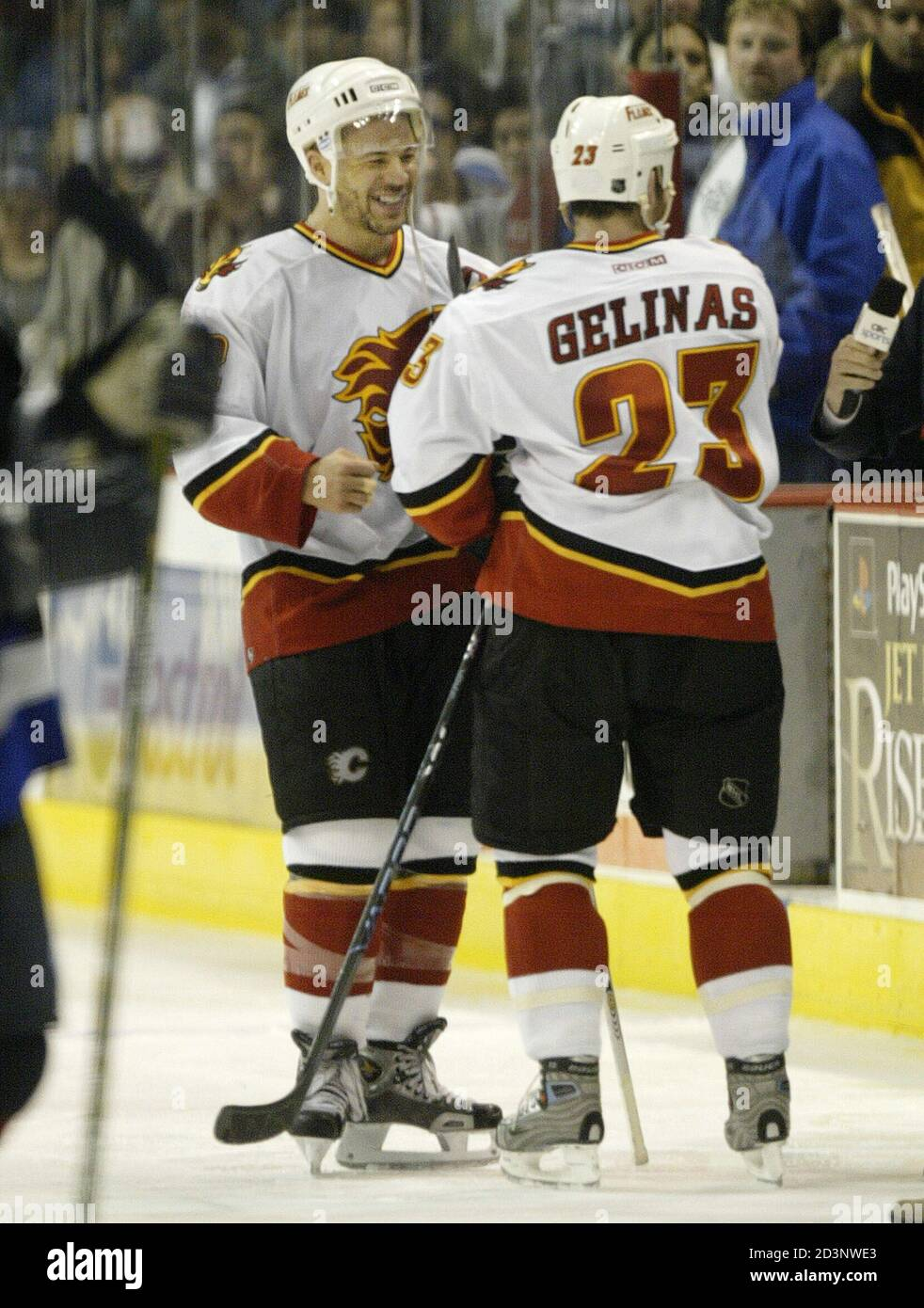 Calgary Flames Players Jarome Iginla L And Martin Gelinas Celebrate Following Their Victory Over The Vancouver Canucks In Vancouver British Columbia April 19 2004 The Flames Advance To The Next Round Of
