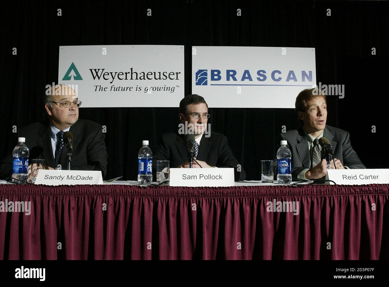 Sandy McDade, President of Weyerhaeuser Company Limited, (L), Sam Pollock, Managing Partner and President of Brascan Investments, (C) and Reid Carter, Managing Partner of Brascan Timberlands Asset Management hold a press conference in Vancouver British Columbia, February 18, 2005. Brascan will purchase Weyerhaeuser's costal assets in Canada for 1.2 billion (CDN), 970 million (USD) plus working capital. REUTERS/Lyle Stafford  LS Stock Photo
