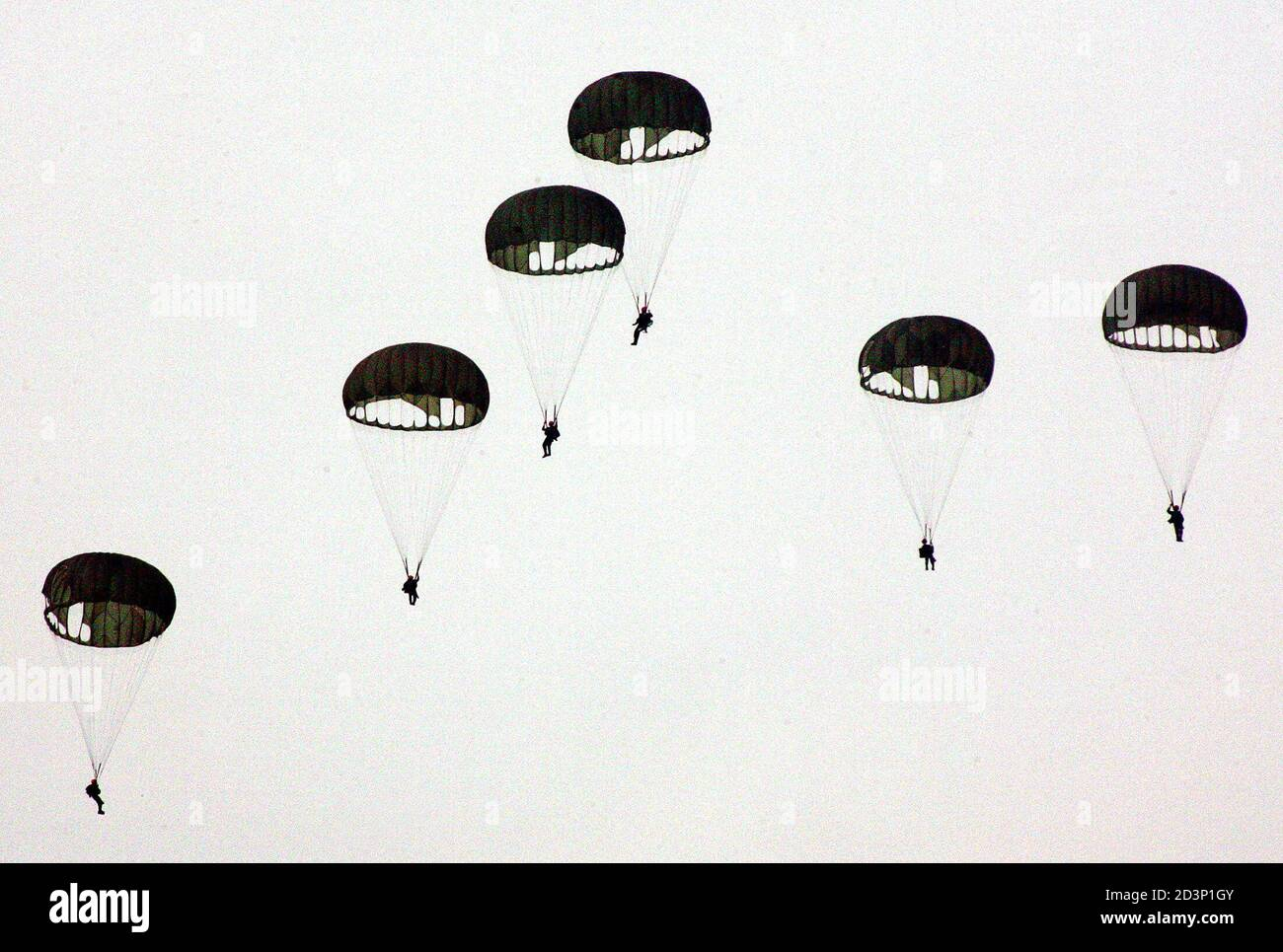 """Parachutes prepare to land during an anti-airborne military exercise at the CCK air base in Taichung, central Taiwan, July 27, 2005. The military exercise, involving simulated repulsion of airborne assaults on an airbase, is part of Taiwan's annual """"Han Kuang"""", or Chinese Glory, exercises aimed at testing the military's readiness against a Chinese invasion. Taiwan President Chen Shui-bian warned on Tuesday that arch-rival China's growing missile build-up not only posed a threat to his democratic island, but also endangered the world. REUTERS/Richard Chung  AH/PN Stock Photo"""