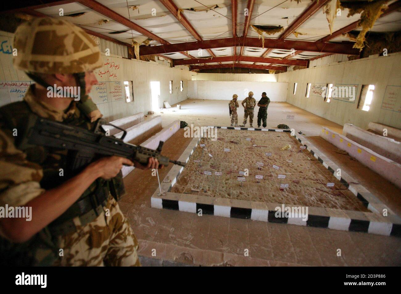 British Soldiers Examine The Briefing Room At An Abandoned Iraqi Base Discovered By Members Of 2