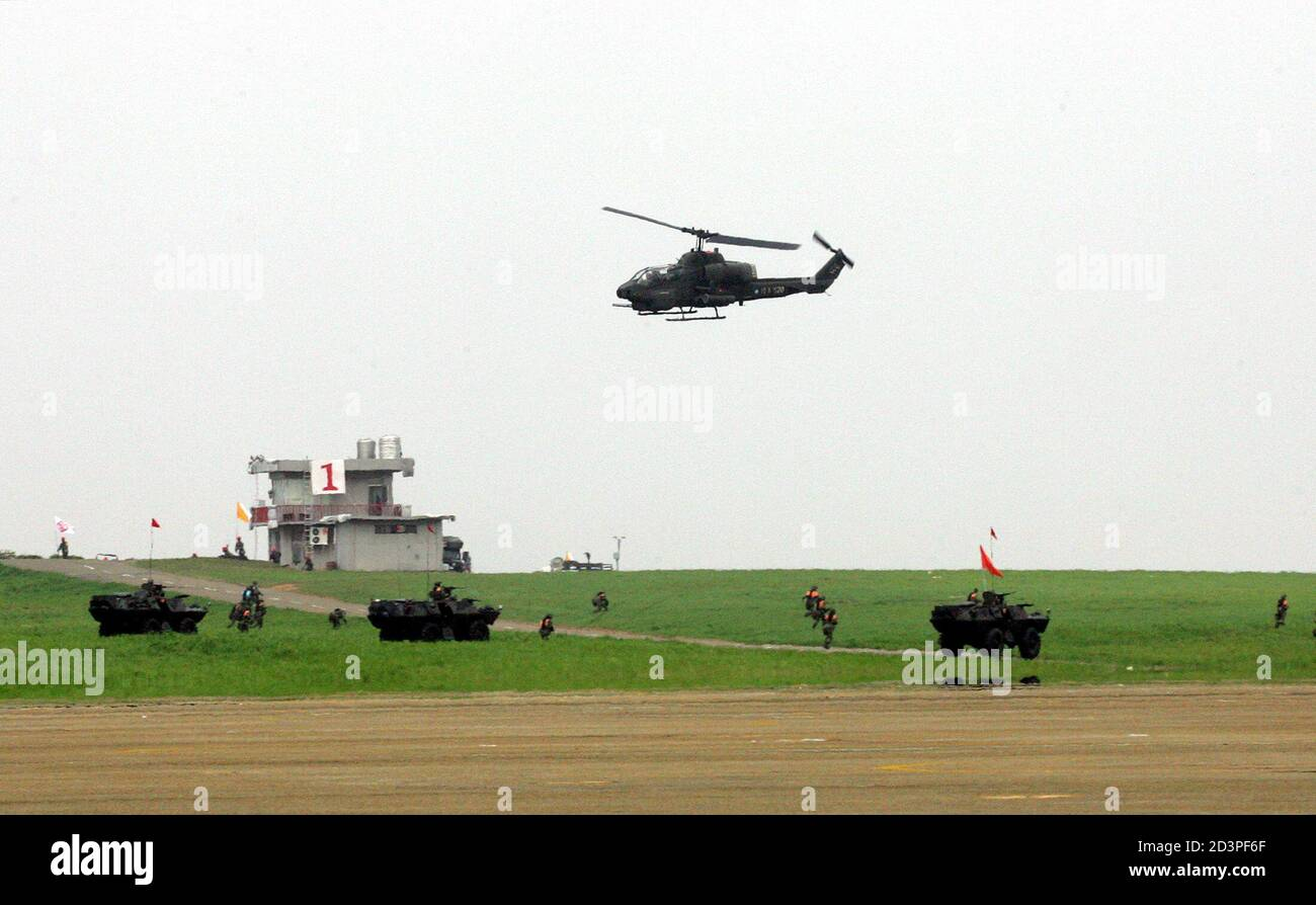 "A Taiwanese AH-1W attack helicopter launches a counter-attack in an anti-airborne exercise at the CCK air base in Taichung, central Taiwan, July 27, 2005. The military exercise, involving simulated repulsion of airborne assaults on an airbase, is part of Taiwan's annual ""Han Kuang"", or Chinese Glory, exercises aimed at testing the military's readiness against a Chinese invasion. Taiwan President Chen Shui-bian warned on Tuesday that arch-rival China's growing missile build-up not only posed a threat to his democratic island, but also endangered the world. REUTERS/Richard Chung  AH/PN Stock Photo"