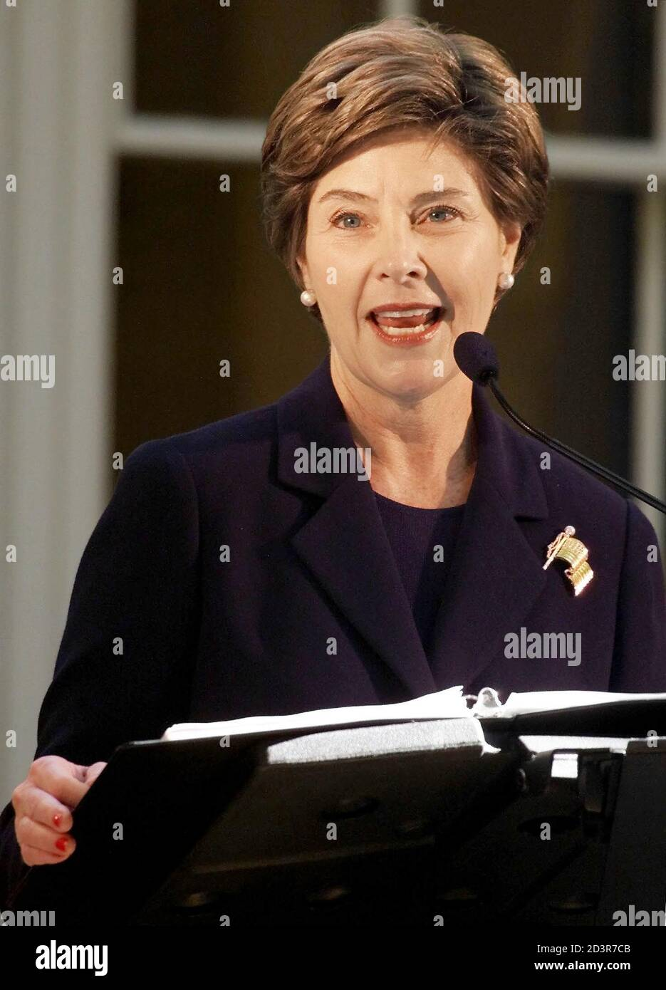 United States first lady Laura Bush speaks at grand opening ceremonies for the newly restored McLellan House and L.D.M Sweat Memorial Galleries at the Portland Museum of Art, October 5, 2002 in Portland, Maine. Stock Photo