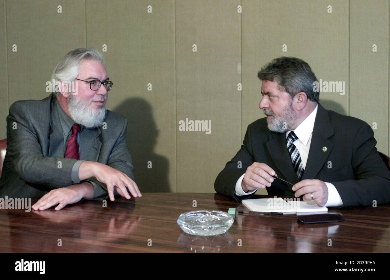 Brazilian President Luiz Inacio Lula da Silva (R) meets with Director General of the International Labor Organization (ILO) Juan Somavia in Brasilia, January 20, 2003. Somavia is in Brazil to further relations and understanding with the ILO and the new government on subjects such as social labor laws, child labor and aspects of slavery. Somavia is from Chile. REUTERS/Jamil Bittar  JB Stock Photo