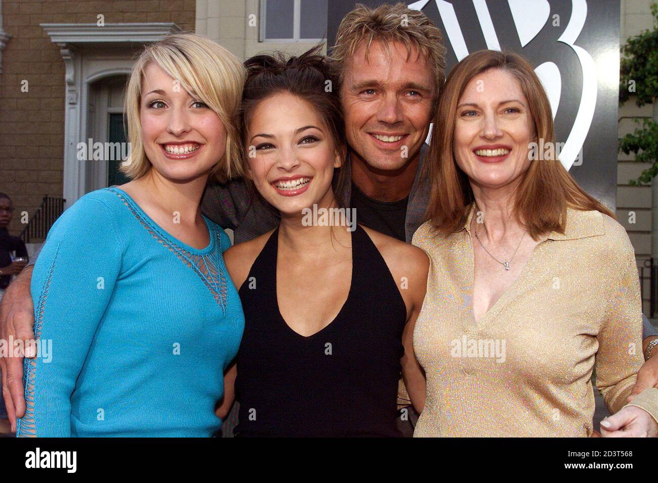 """Actor John Scheneider poses with co-stars (L-R) Allison Mack, Kristin Kreuk and Annette O'Toole from the new WB television network action series """"Smallvile""""  at the network's summer All-Star party at the Warner Bros. Studios in Burbank, California, July 15, 2001. The series depicts the classic Superman character as a teenaged Clark Kent. Stock Photo"""