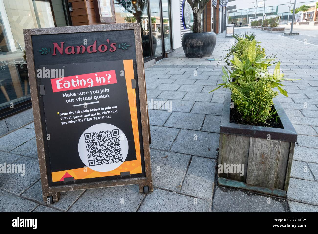 A QR code or matrix barcode outside Nando's restaurant to be scanned with a mobile phone app to join the virtual queue, UK, October 2020 Stock Photo