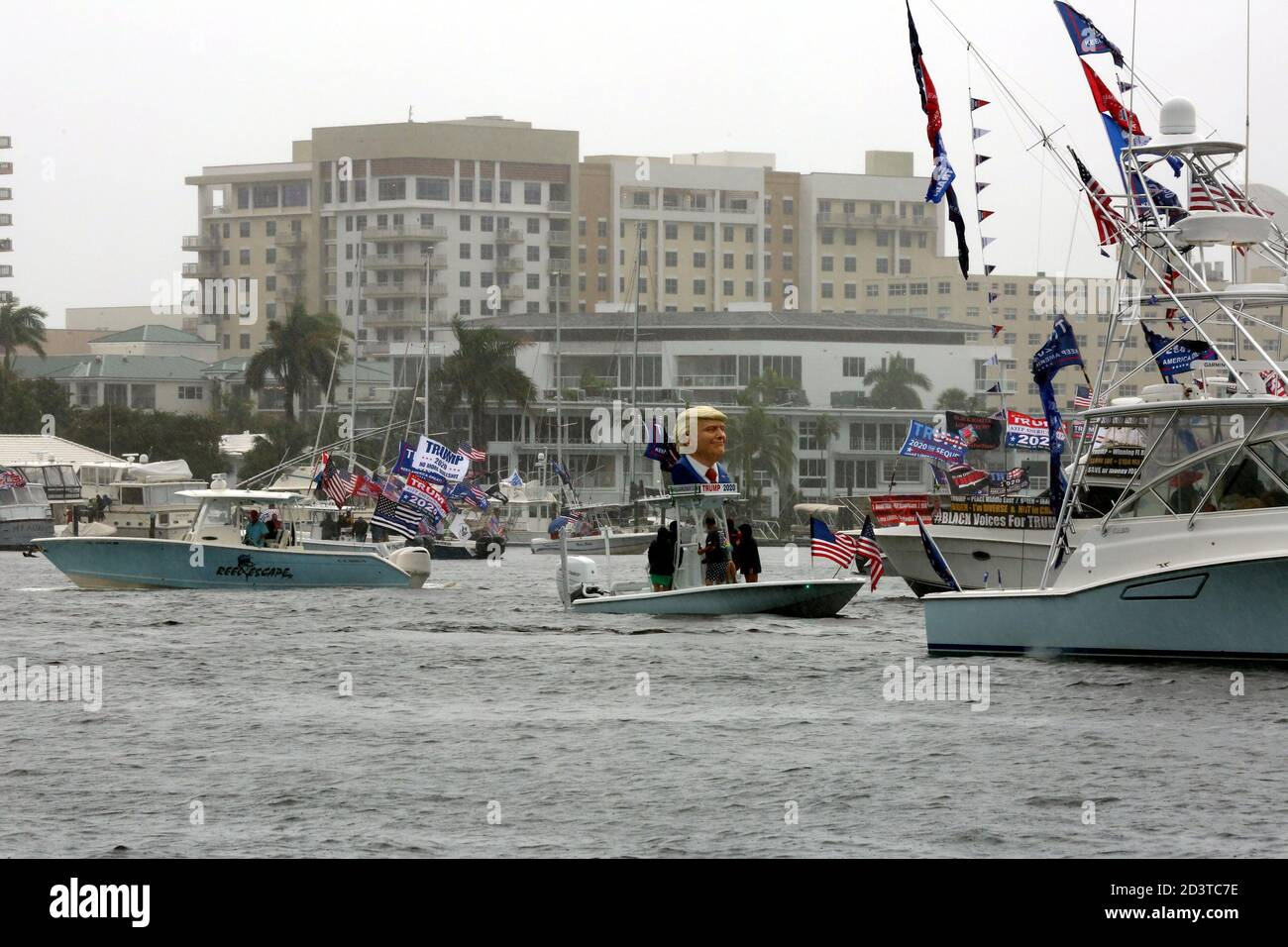 Donald Trump fans were out in their boats in droves during torrential rain to show their support during today's Trump 2020 Flotilla along the Intracoastal Waterways that began at Fort Lauderdale Sunrise Bay and ended at Boca Lake in Boca Raton with some sunshine.  The Avid supporters from 'Boaters For Trump South Florida' proudly Promoted the COVID stricken President for his 2020 Re-election during today's Trump 2020 Flotilla.  Jim Norton (US House of Rep), Catherine McBreen (Supervisor Board of Elections), Brian Norton (State Senator)and Carla Spalding (running against Debbie Wasserman-Schult Stock Photo