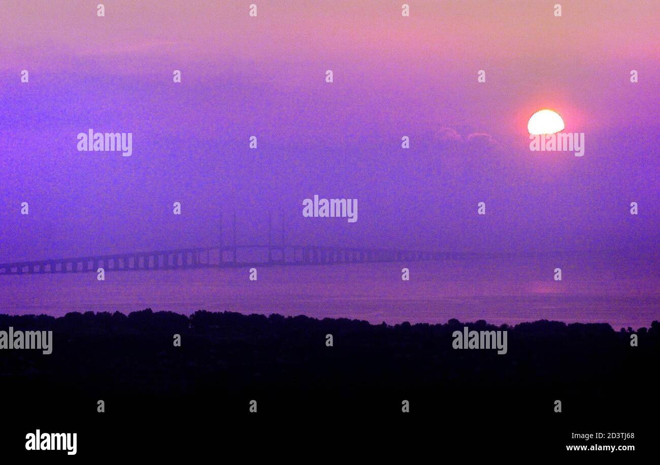 """Sun rises above Penang Bridge which leads to the Malaysia's island state of Penang, April 18, 2001. Electronics industry workers in Penang, also known as """"Silicon Island"""", are watching their backs but so far the tropical technology hub has escaped the worst of a global round of high-tech sackings. Picture taken on April 18, 2001.  BM/CC Stock Photo"""