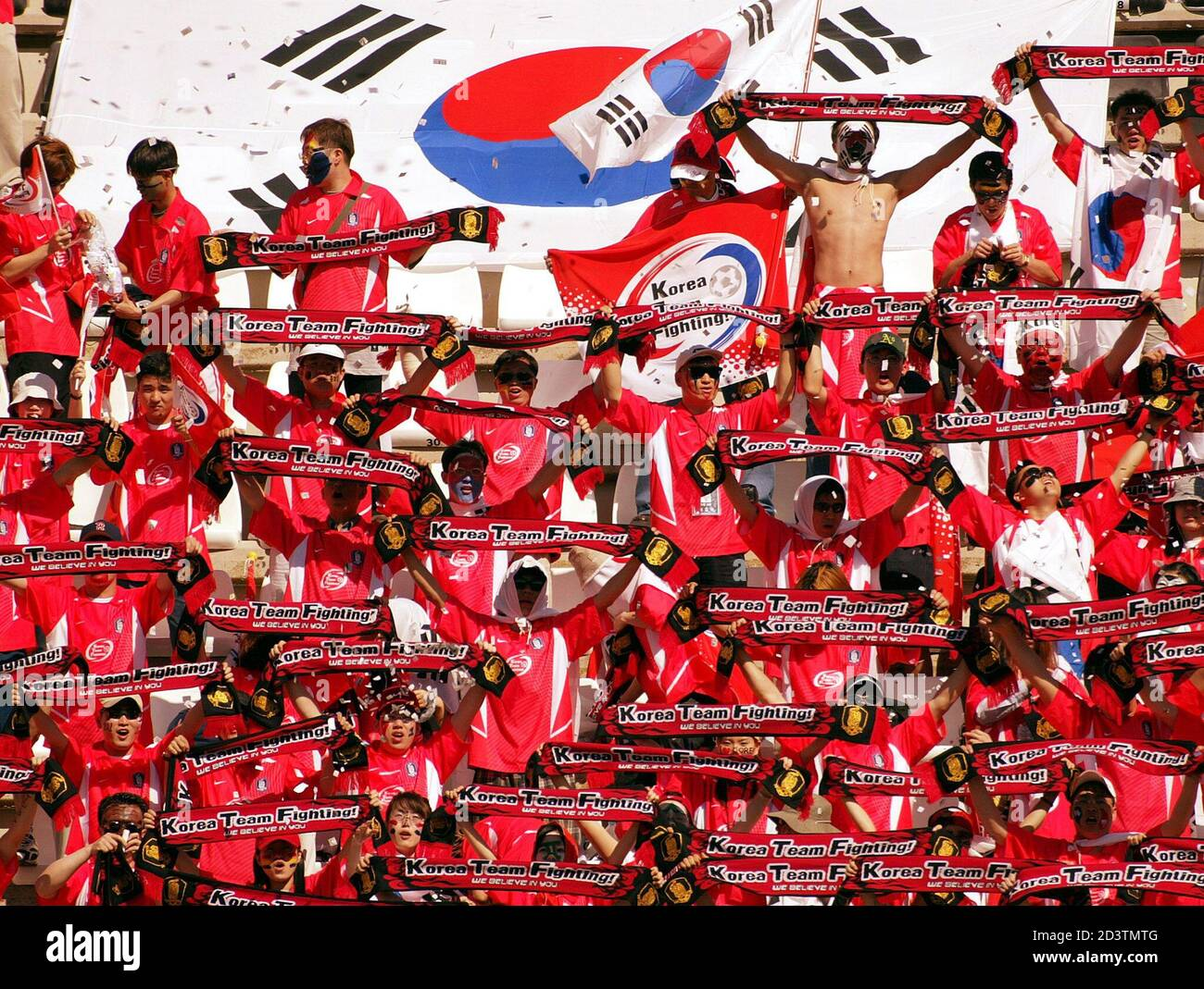South Korean supporters cheer their team during a friendly soccer match against Finland March 20, 2002 in Cartagena in Eastern Spain. The teams of Korea and Finland are training on the Eastern Spanish coast for the upcoming World Cup. REUTERS/Desmond Boylan  DB Stock Photo