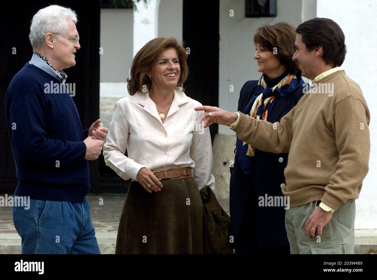 Spanish Prime Minister Jose Maria Aznar (R) talks with his French counterpart Lionel Jospin (L) as they pose with their wives Ana Botella (2nd L) and Silian Jospin before their meeting at Quintos de Mora near Madrid May 5, 2001. Jospin is Spain for a two-day private visit.  SP Stock Photo