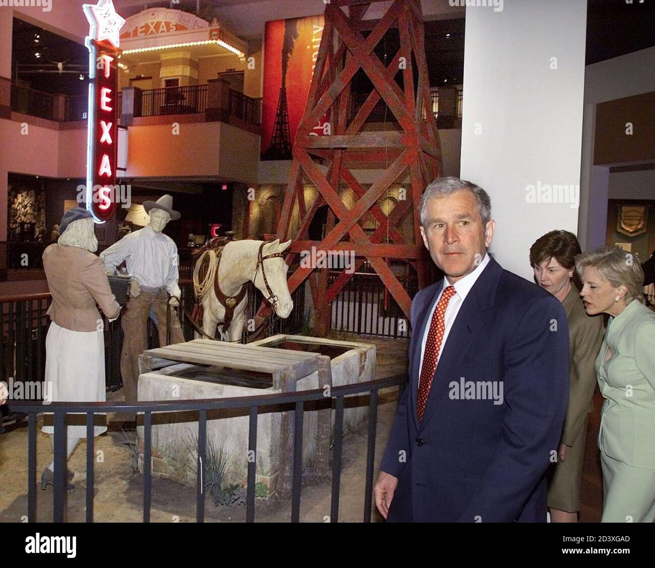 U.S. President George W. Bush and first lady Laura Bush are given tour of the Bob Bullock Texas History Museum by Anne Johnson (R) while in Austin, Texas, April 27, 2001. The president attended the dedication and opening ceremony for the museum named after former Texas Lt. Govenor Bob Bullock.  LSD Stock Photo