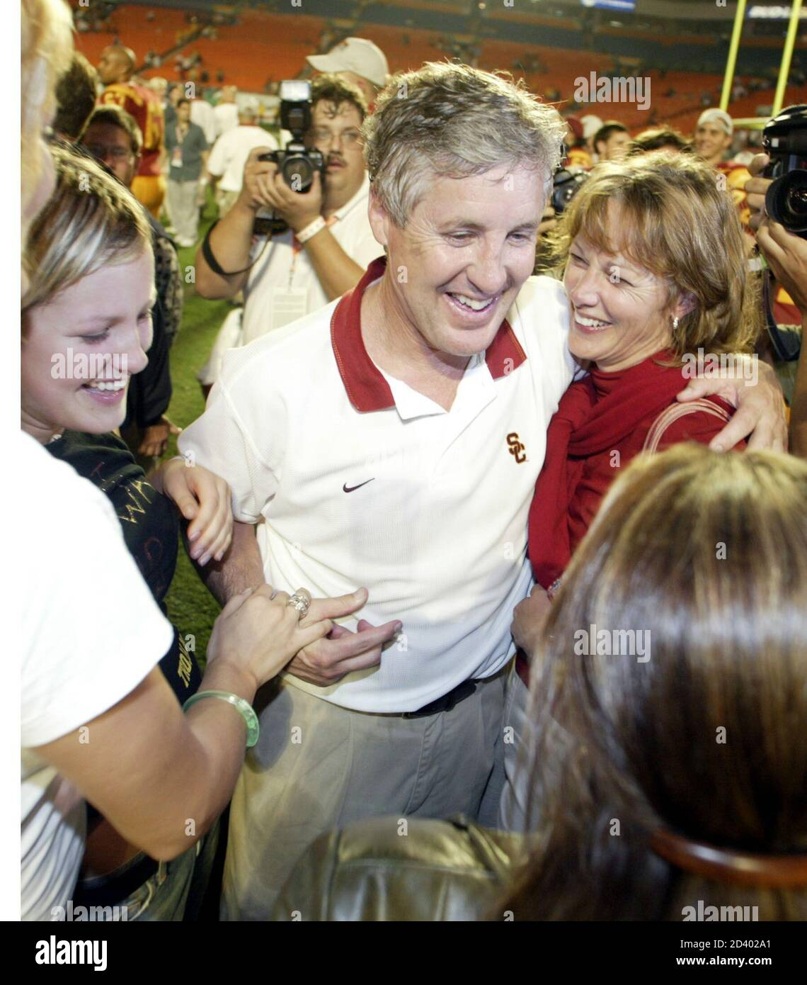 University Of Southern California Trojans Coach Pete Carroll Hugs His Wife Glenna R After Winning The Orange Bowl At Pro Player Stadium In Miami Florida On January 2 2003 Usc Defeated Iowa