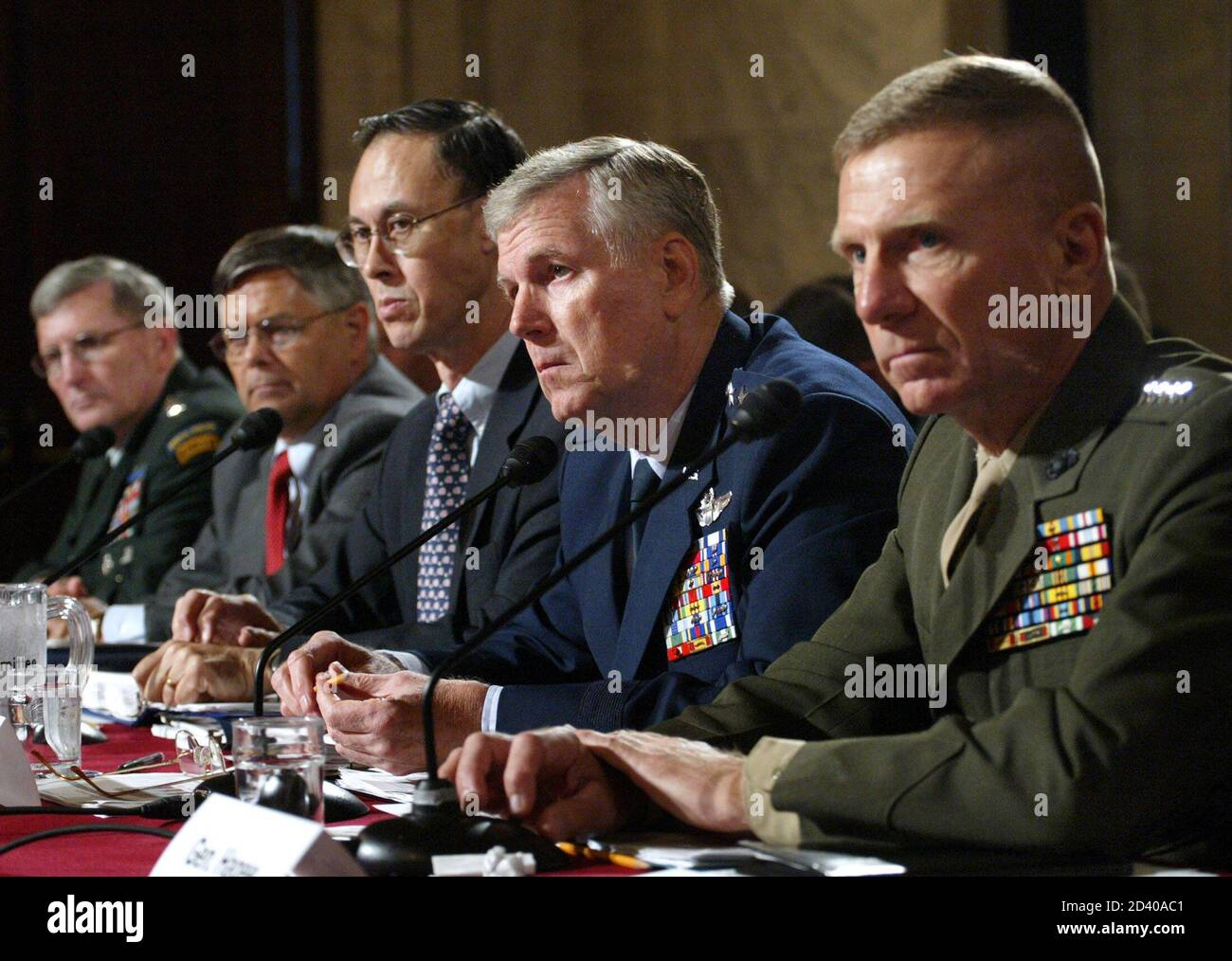 (Left to right) U.S. Army Gen. Peter Schoomaker, Principal Deputy Undersecretary of Defense for Personnel and Readiness Charles Abell, Undersecretary of Defense for Personnel and Readiness, David Chu, General Richard Myers, Chief of Staff, and Commandant, U.S. Marine Corps Gen. Michael Hagee testify at a hearing on fighting the global war on terrorism at the Senate Armed Services Committee on Capitol Hill in Washington D.C., June 30, 2005. REUTERS/Yuri Gripas  YG/KS Stock Photo