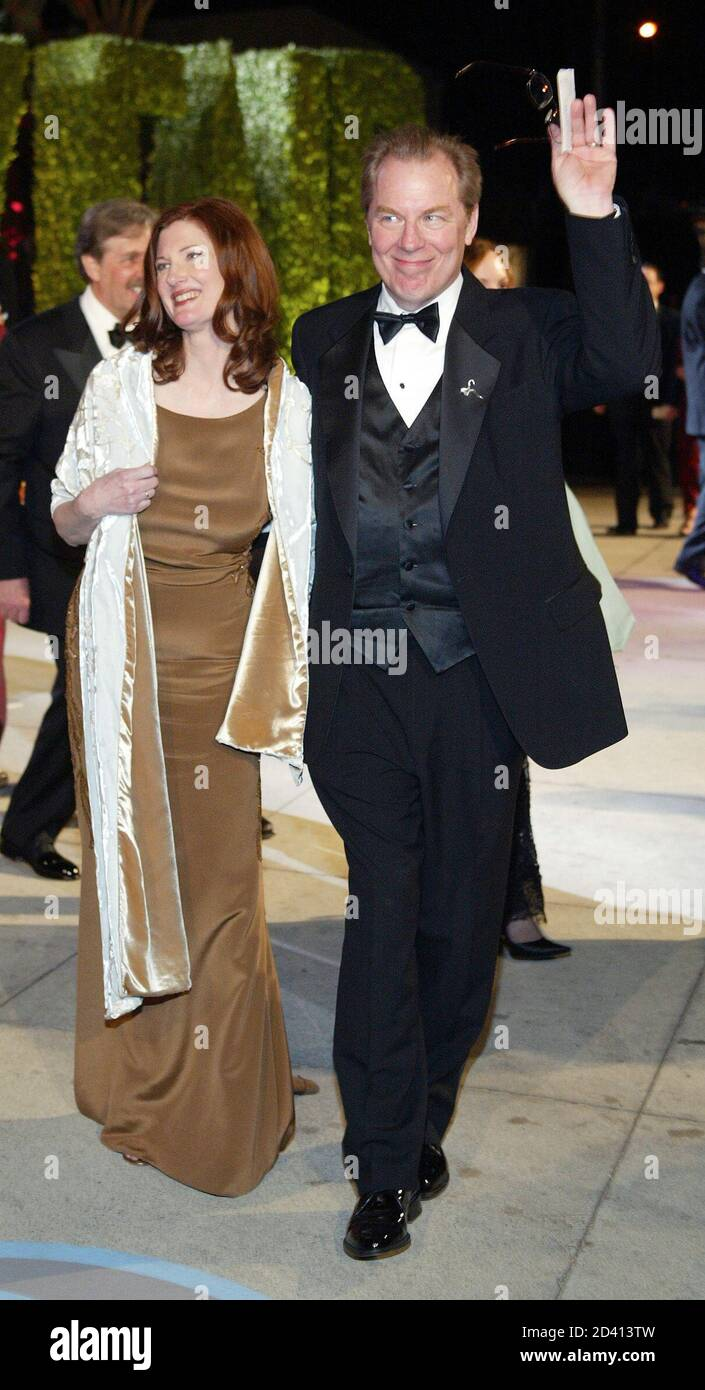 Annette O'Toole and Michael McKean leave the Vanity Fair Oscar party at Morton's restaurant in West Hollywood, California, early March 1, 2004. REUTERS/Ethan Miller  EM Stock Photo