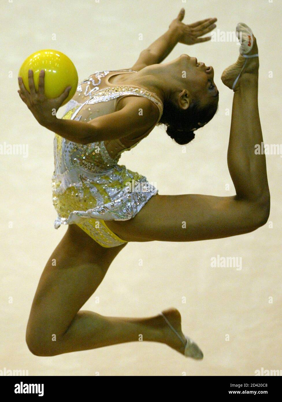 Maria Aristotelous from Cyprus performs during the individual all-around rhythmic gymnastics competition at the 22nd Summer Universiade Games in Kyeongju August 23, 2003. REUTERS/Kim Kyung-Hoon  KKH/RCS Stock Photo