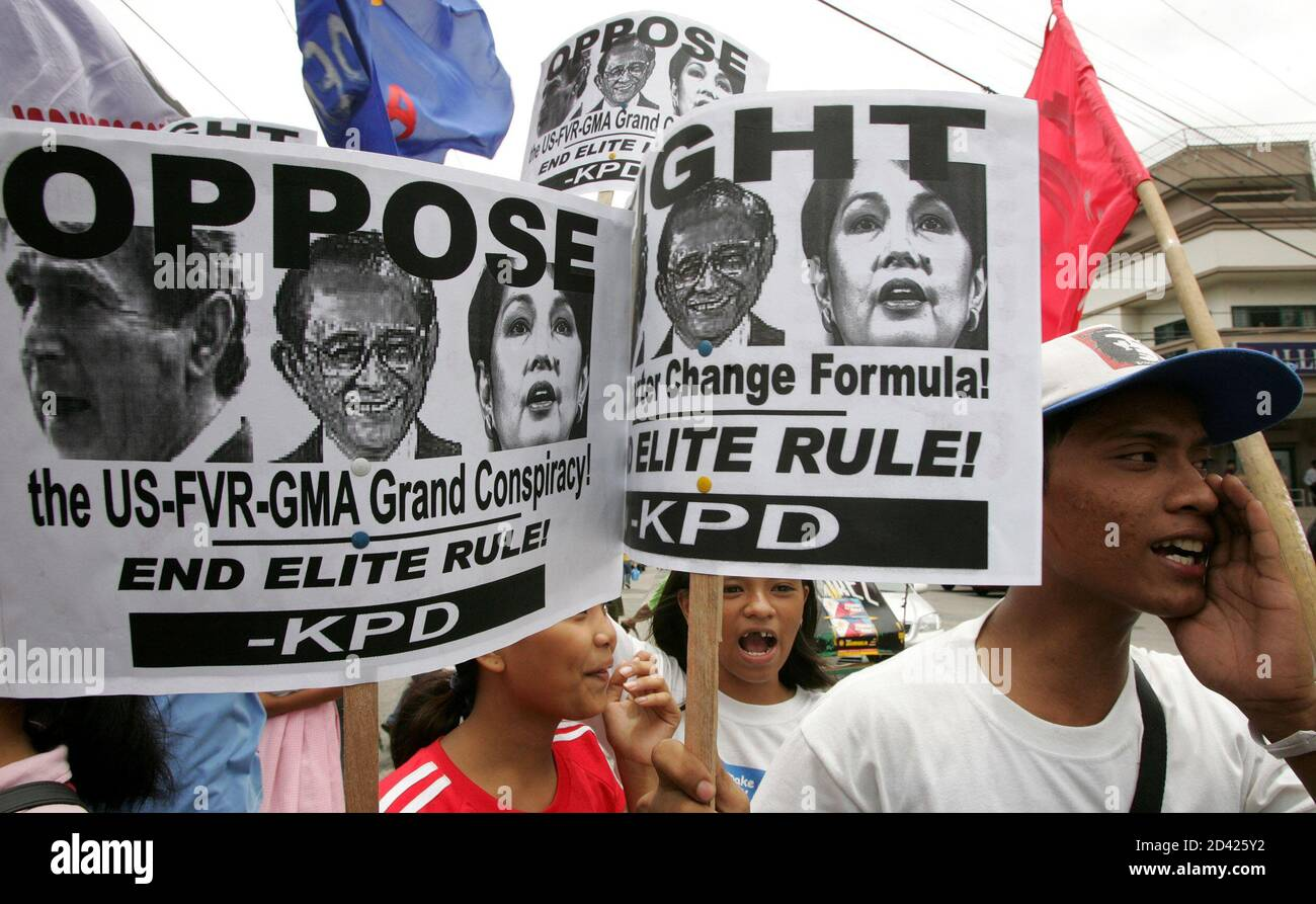 Filipino protesters display anti-government placards while shouting for the resignation of President Gloria Macapagal Arroyo during a protest outside the presidential palace in Manila July 19, 2005. Arroyo will form a truth commission to investigate vote-rigging allegations she faces over last year's presidential poll, her spokesman said on Tuesday. REUTERS/Romeo Ranoco  RR/CCK Stock Photo