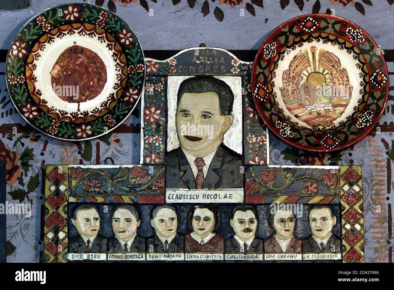 -PHOTO TAKEN 03JUL04- A carved wood panel featuring Stalinist Dictator Nicolae Ceausescu and communist central committee members is exhibited in the memorial house of Stan Ion Patras - the founder of the Merry Cemetery of Sapanta, [700km northwest of Bucharest], in this July 3, 2004 file picture. Bursting with colour, life and history, hundreds of brilliantly decorated wooden crosses have marked the graves of villagers since an imaginative local wood carver started this unique tradition in the 1930s. Stock Photo