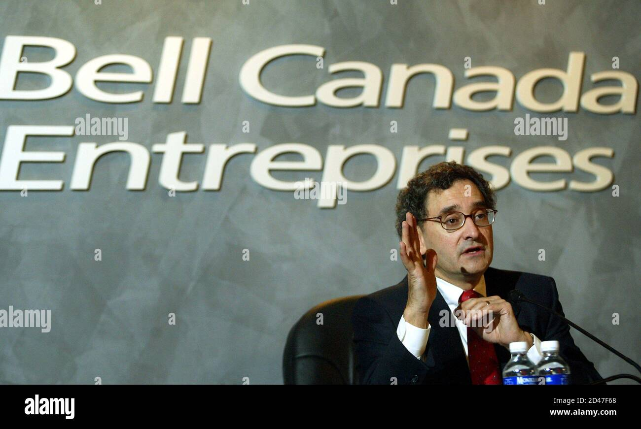 Bell Canada Enterprises' President and Chief Executive Officer, Michael Sabia gestures during a press conference held after BCE's Annual Meeting of the Shareholders in Montreal on May 28, 2003. BCE, Canada's largest telecommunications group, stated it would streamline its Bell Canada unit into three customer-focused units, but does not expect the changes to involve major job cuts or affect its earnings outlook for the current year. REUTERS/Christinne Muschi  CM Stock Photo