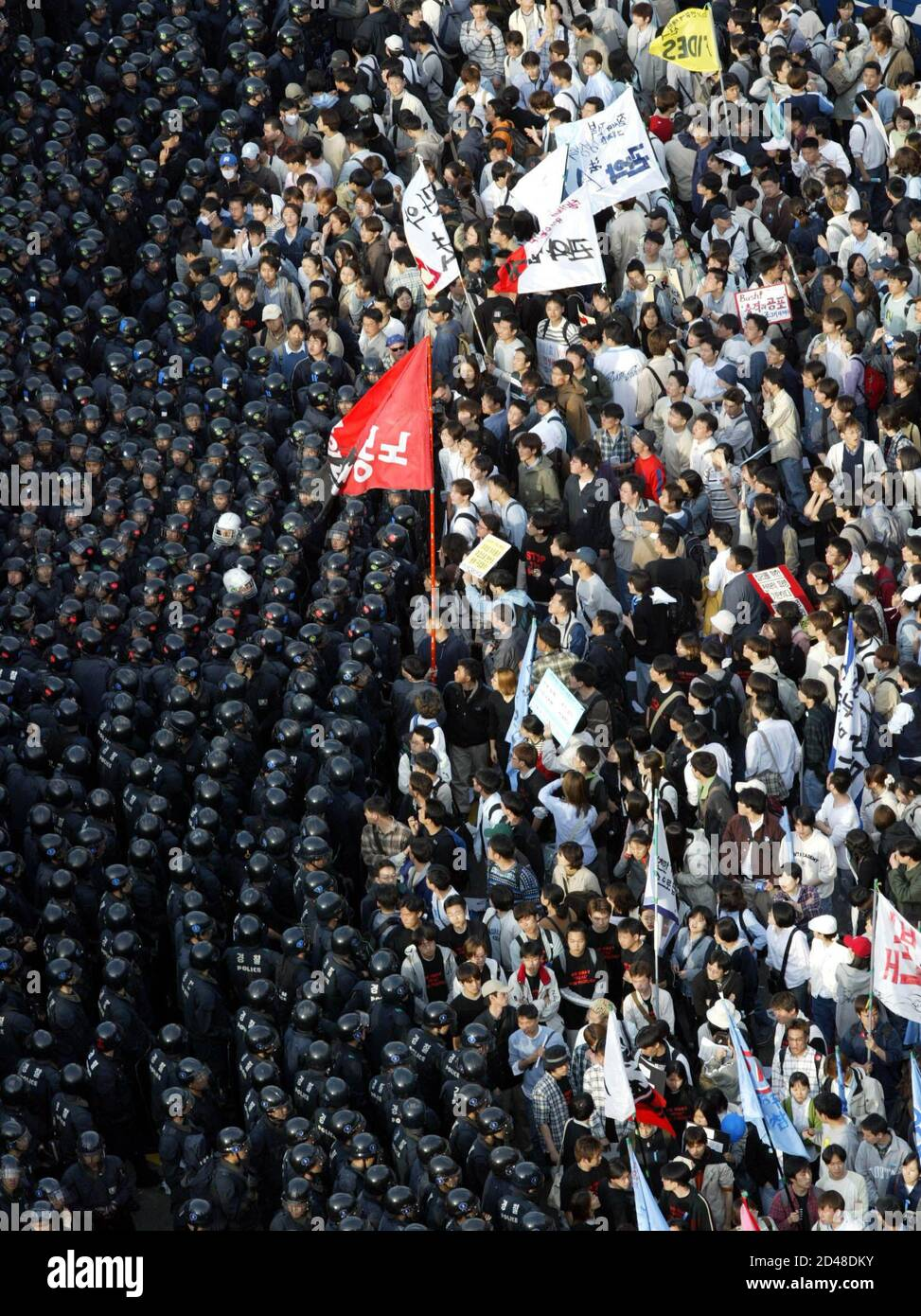 Riot police block protesters trying to march to National Assembly in Seoul April 2, 2003. South Korea's National Assembly voted on Wednesday to send about 700 medical and engineering personnel to Iraq after President Roh Moo-hyun told lawmakers that cementing close ties with Washington was key to securing peace on the divided Korean peninsula. REUTERS/Kim Kyung-Hoon  LJW/DL Stock Photo