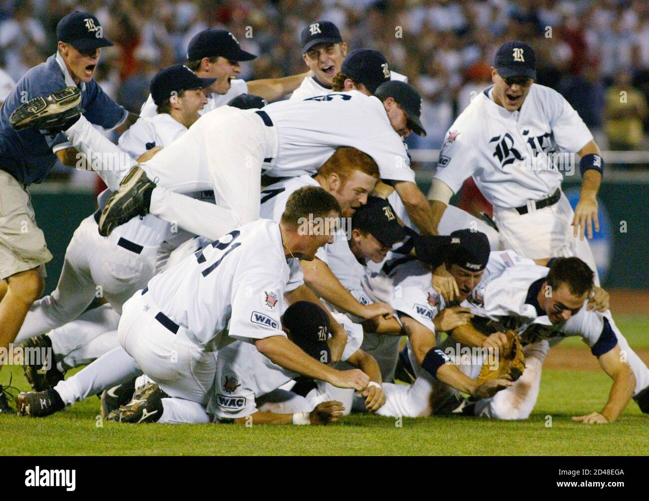 Rice Owls players celebrate winning the College Baseball World Series, beating Stanford two games to one in Omaha, Nebraska June 23, 2003. The 14-2 victory gave Rice their first national championship in any NCAA team sport. At left is Rice pitcher Philip Humber (21), who pitched a complete game. REUTERS/Rick Wilking  RTW/SV Stock Photo