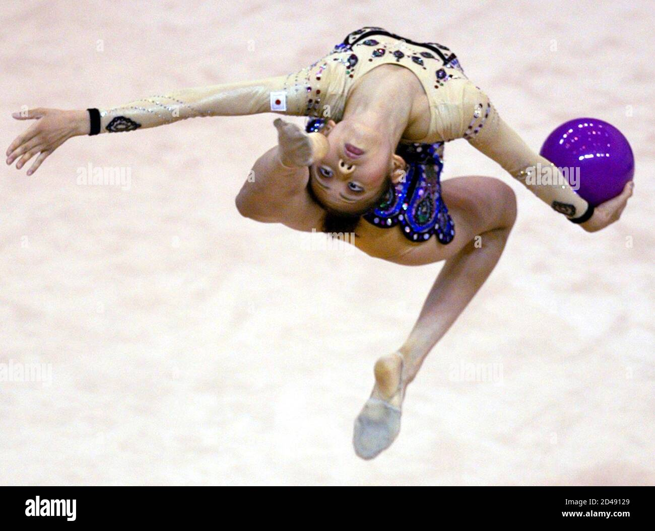 Hayashi Yoshie from Japan performs during the individual all-around rhythmic gymnastics competition at the 22nd Summer Universiade Games in Kyeongju August 23, 2003. REUTERS/Kim Kyung-Hoon  KKH/RCS Stock Photo