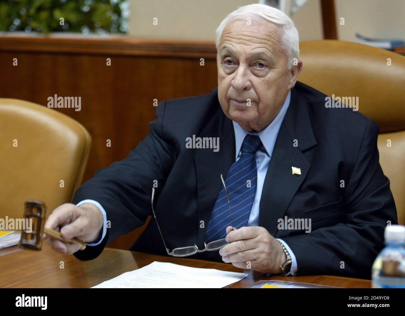 Israeli Prime Minister Ariel Sharon attends the weekly cabinet meeting in Jerusalem 19 January 2003. Sharon's rightist Likud party is ahead in opinion polls ahead of a general election nine days away. REUTERS/Menahem Kahana/Pool  MJO/FMS Stock Photo