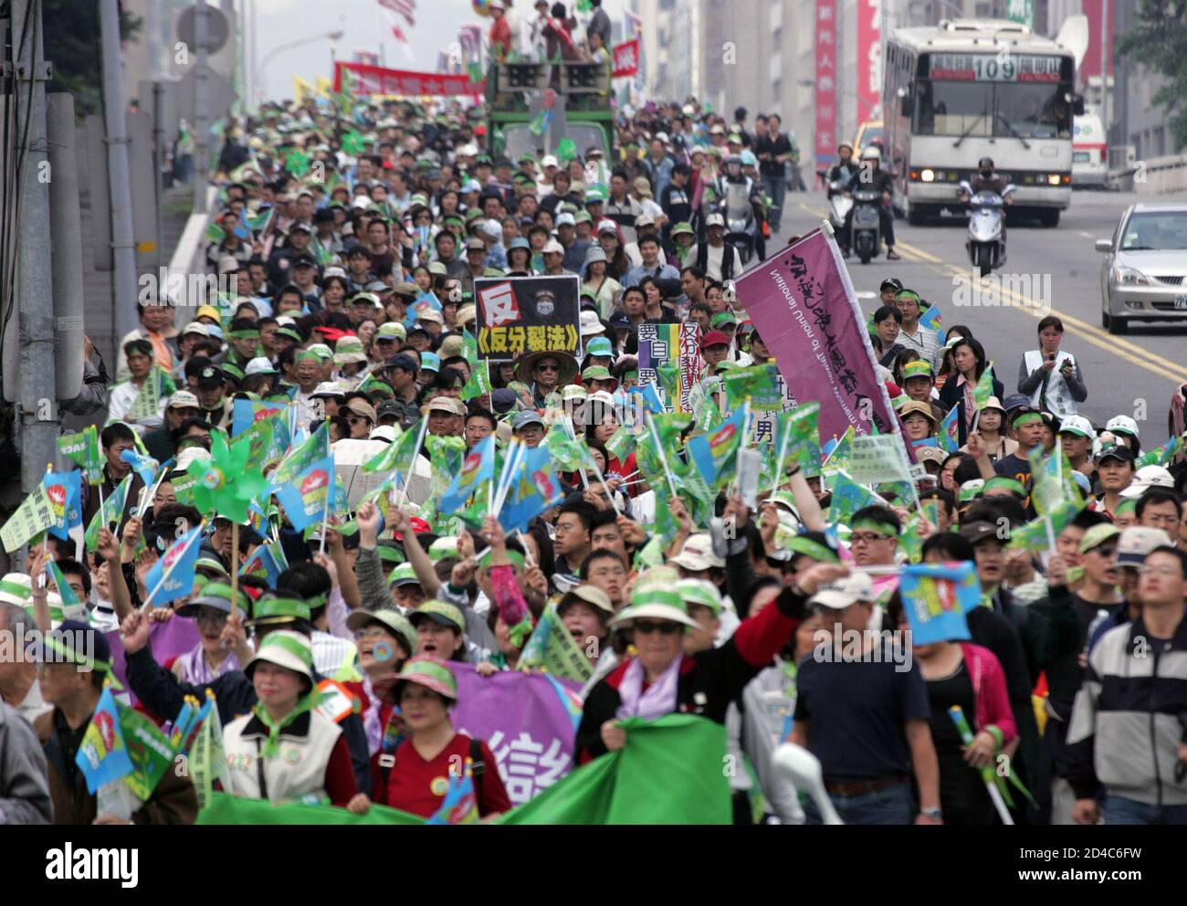"""Hundreds of thousands of people chanting """"Oppose war, Love Taiwan"""" join a protest against China's military threat in Taipei March 26, 2005. Organisers aimed to rally one million people in a show of people power against Beijing's anti-secession law, which sanctions the use of force against the island, but Taipei police estimated the crowd at just more than 230,000 so far. REUTERS/Richard Chung  TW/CCK Stock Photo"""