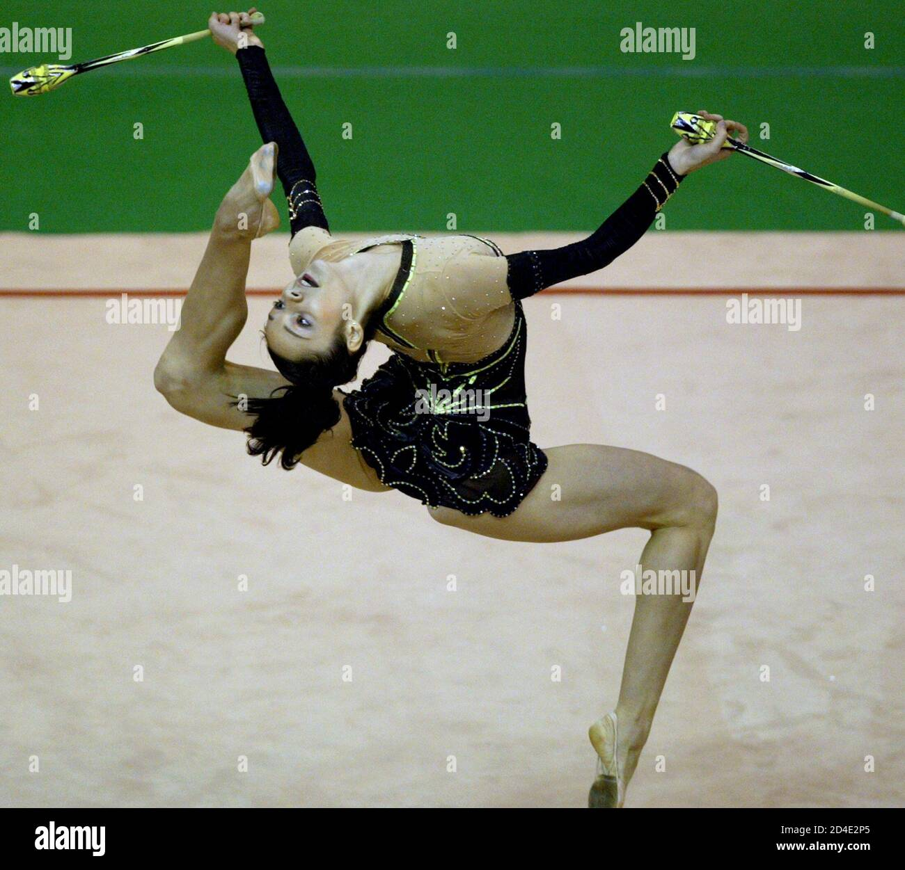 Anna Bezsonova from the Ukraine performs with clubs during the individual finals of the rythmic gymnastics at the 22nd Summer Universiade Games in Kyeongju August 25, 2003. Bezsonova won the silver medal with the score of 28.175. REUTERS/Kim Kyung-Hoon  KKH/RCS Stock Photo