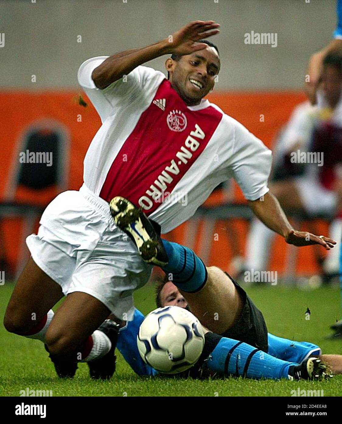 Ajax Player Wamberto Falls As He Is Tackled By Andre Ooijer Of Psv In Their Dutch
