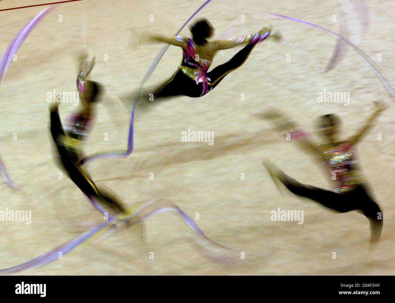SOUTH KOREAN PLAYERS PERFORM DURING THE FINAL OF RYTHMIC GYMNASTICS AT THE UNIVERSIADE GAMES IN KYEONGJU. Stock Photo
