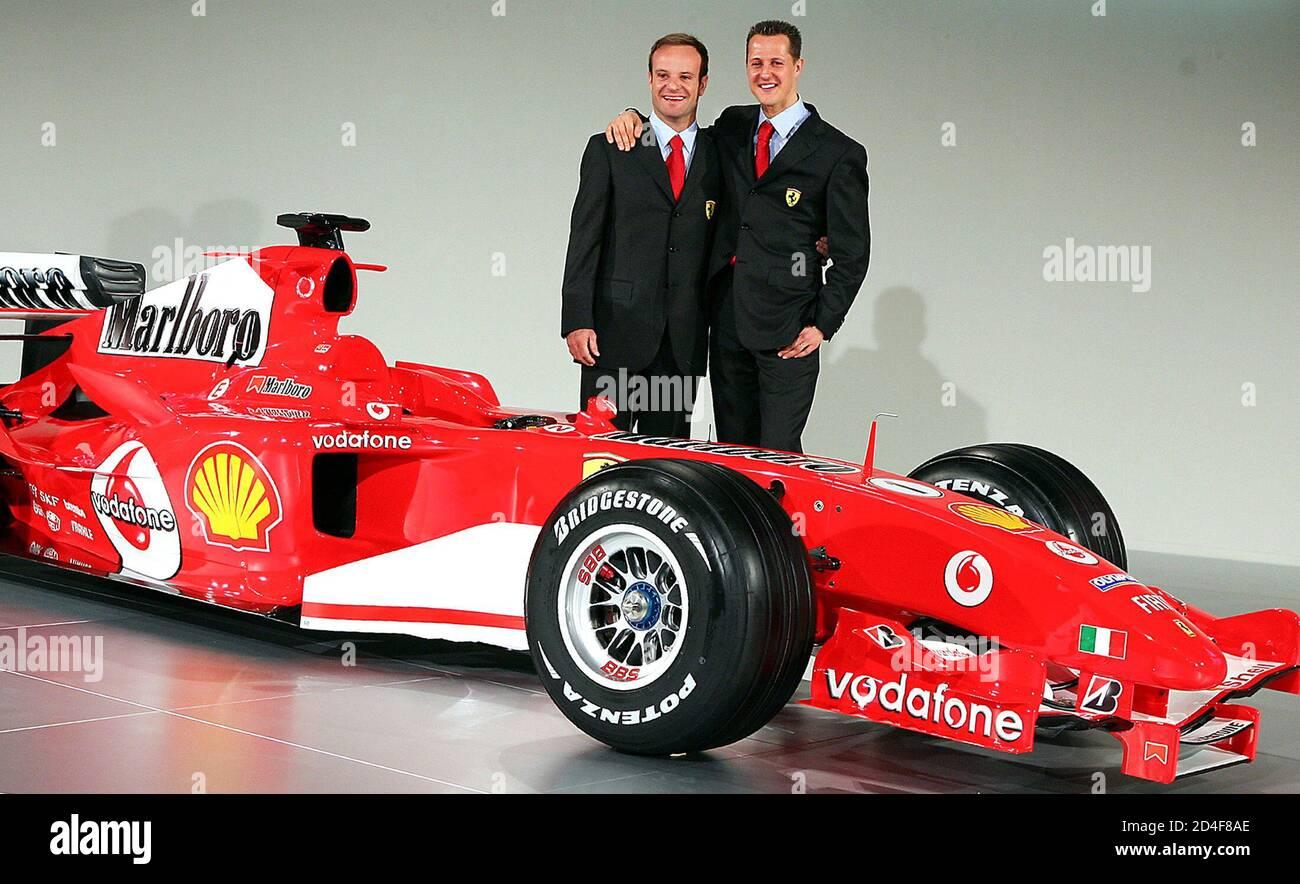 German Ferrari Driver Michael Schumacher And Team Mate Brazilian Ruben Barrichello Pose With The New F2005
