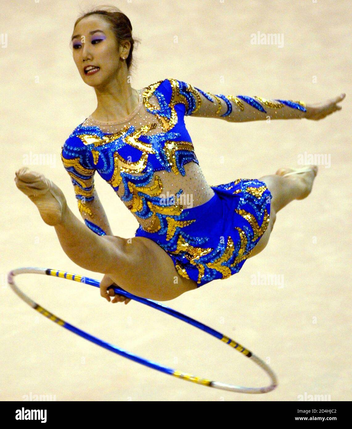 Choi Ye-lim from South Korea performs during the individual all-around rhythmic gymnastics competition at the 22nd Summer Universiade Games in Kyeongju August 23, 2003. REUTERS/Kim Kyung-Hoon  KKH/RCS Stock Photo