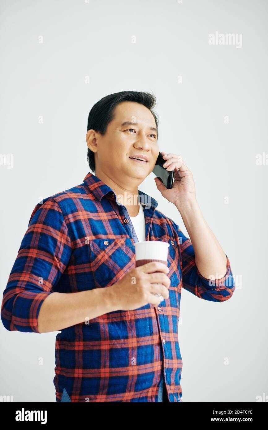 Vietnamese man talking on phone Stock Photo