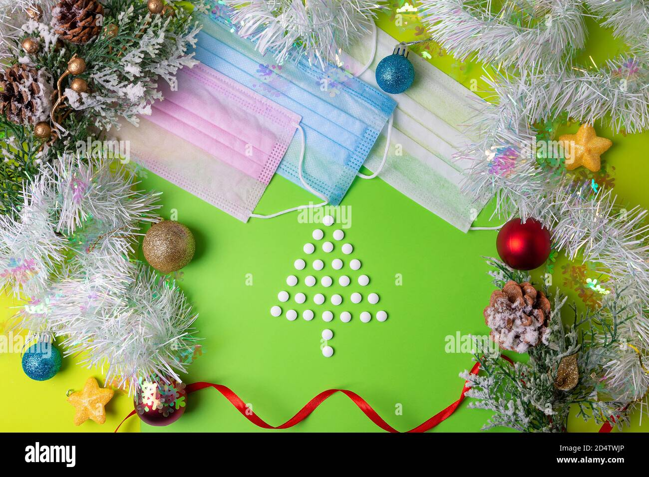 Christmas 2021 Tablets Tablets In The Form Of A Christmas Tree Pink Blue And White Medical Masks On A Green Background New Year And Christmas 2021 New Year Concept Durin Stock Photo Alamy