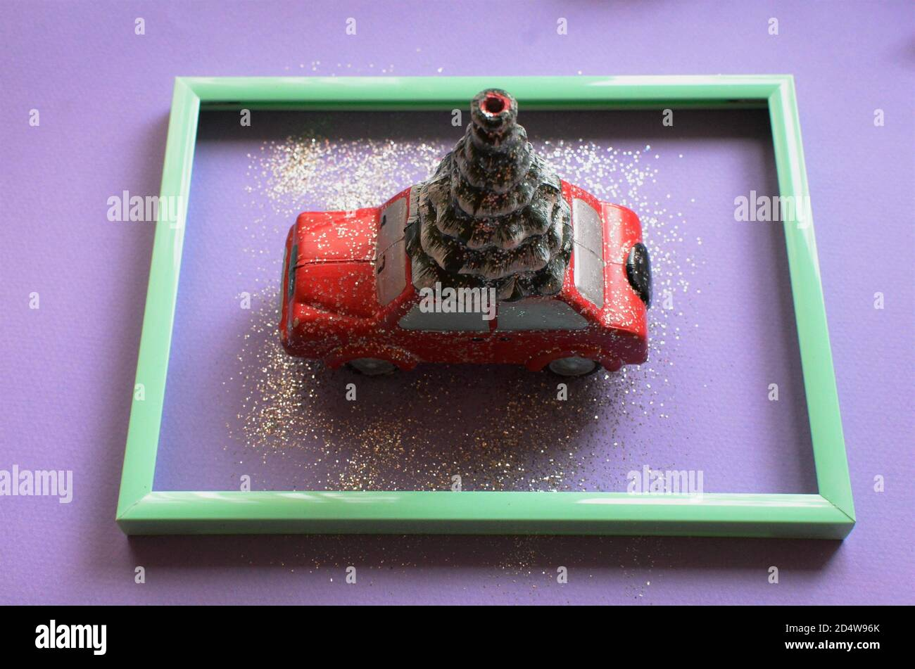 A Red Car With A Christmas Tree In A Mint Green Frame On A Purple Background Creative New Year Concept Stock Photo Alamy