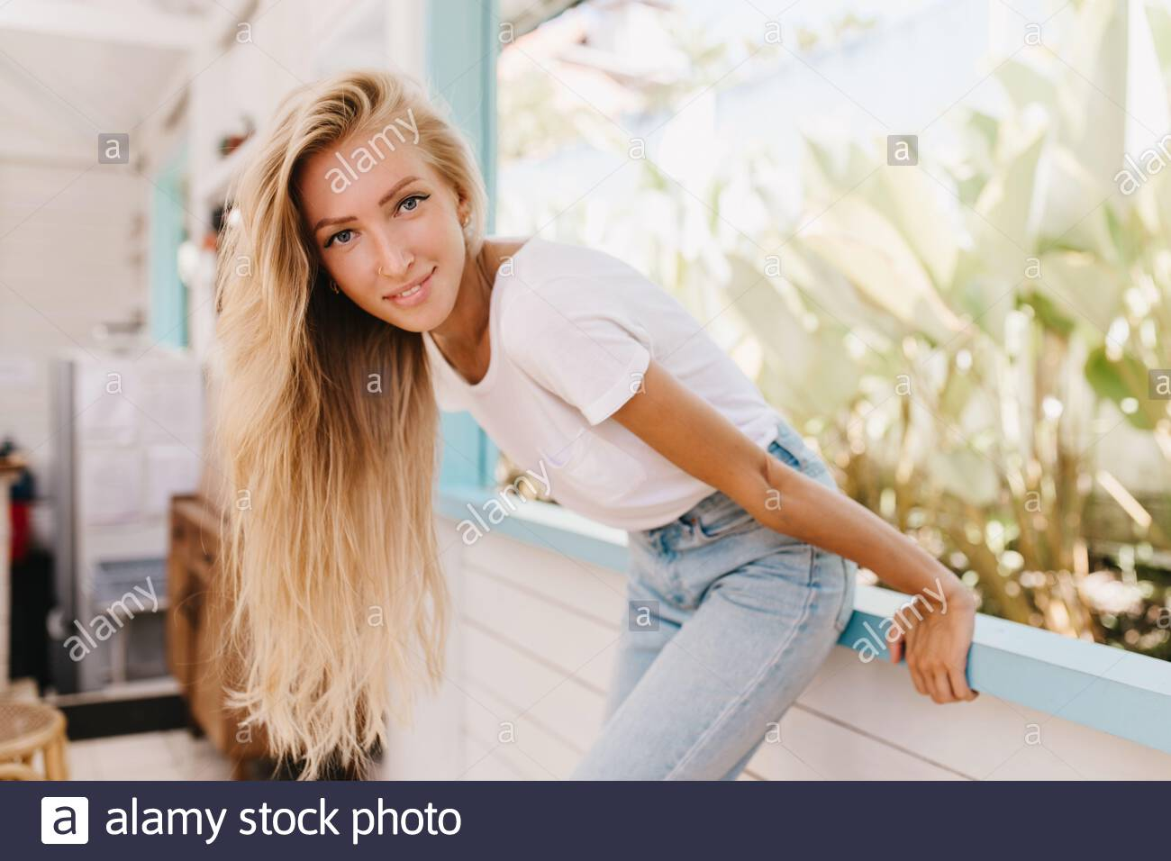 Woman Long Blonde Hair Tanned High Resolution Stock Photography And Images Alamy
