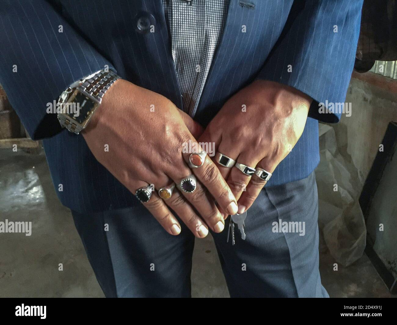 A man wearing rings on all his fingers, who is a Bangladeshi migrant in Malaysia Stock Photo - Alamy