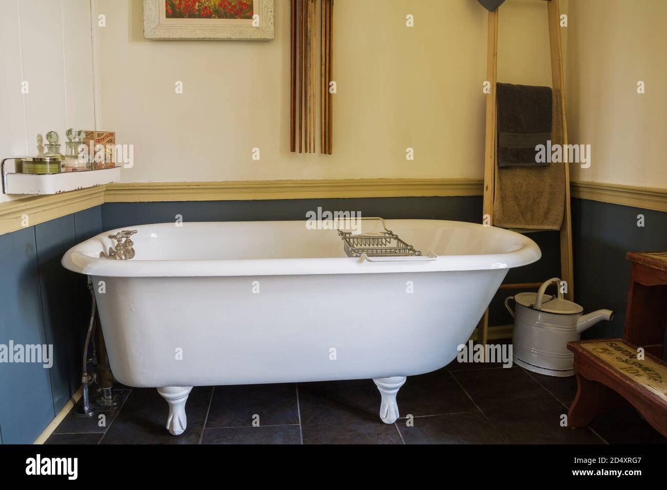 White Claw Foot Bathtub In Main Bathroom With Black Ceramic Tile Floor Inside An Old 1841 Cottage Style Fieldstone House Stock Photo Alamy