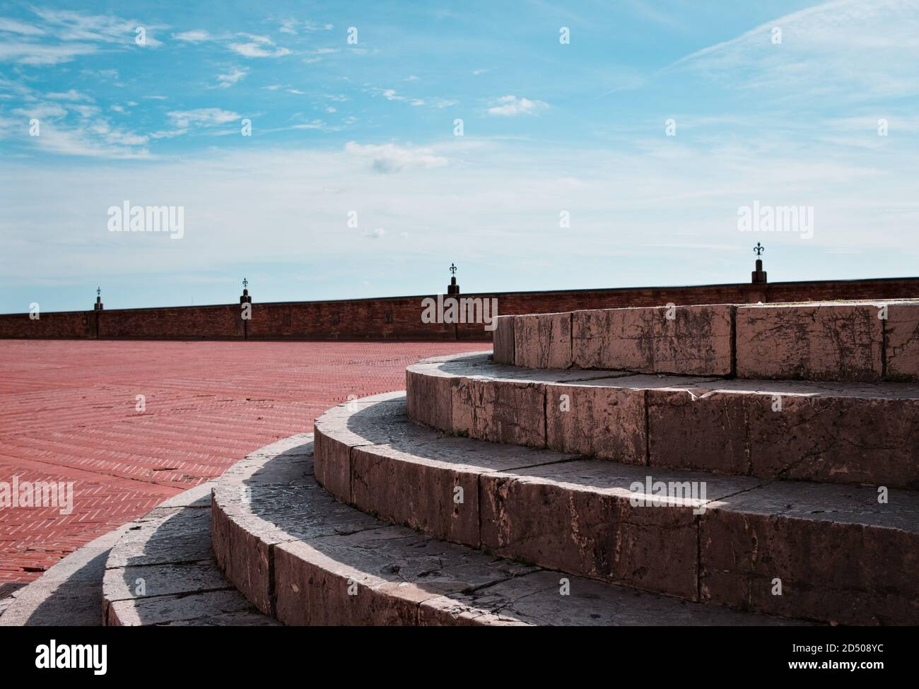 A detail of a circular stone staircase in an empty square (Gubbio, Umbria, Italy) Stock Photo
