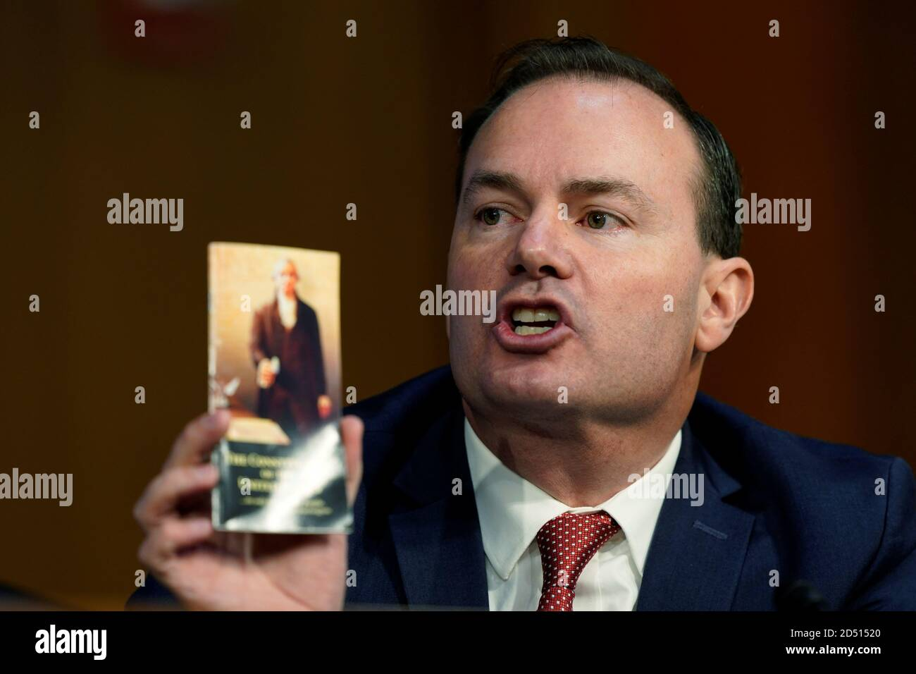 U.S. Senator Mike Lee (R-UT), who recently tested positive for coronavirus disease (COVID-19), holds a pocket copy of the U.S. Constitution as he speaks during of a confirmation hearing of Judge Amy Coney Barrett on Capitol Hill in Washington, D.C., U.S., October 12, 2020. Susan Walsh/Pool via REUTERS Stock Photo