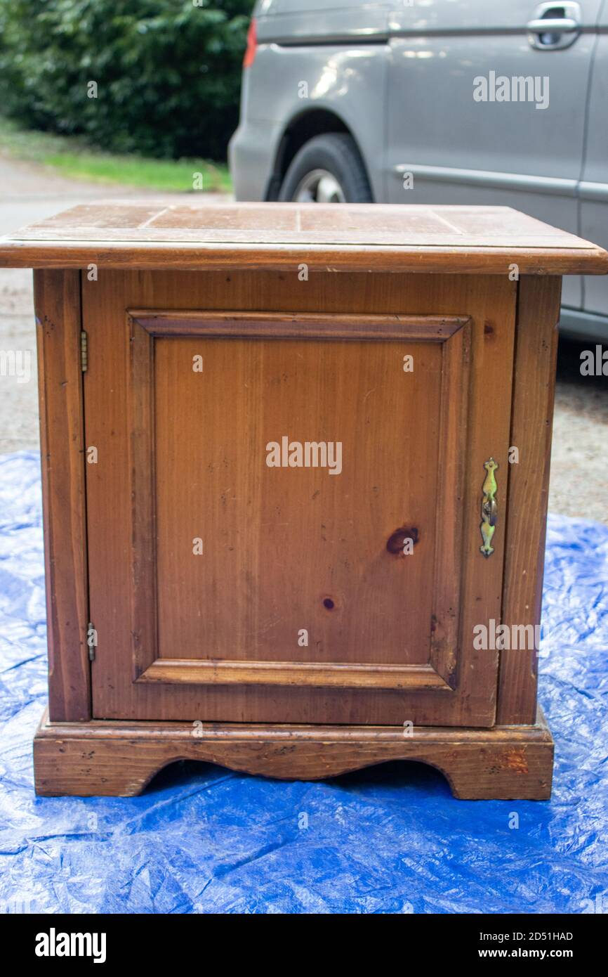 Old Antique Side Table Set Out On A Blue Tarp Being Refinished Stock Photo Alamy