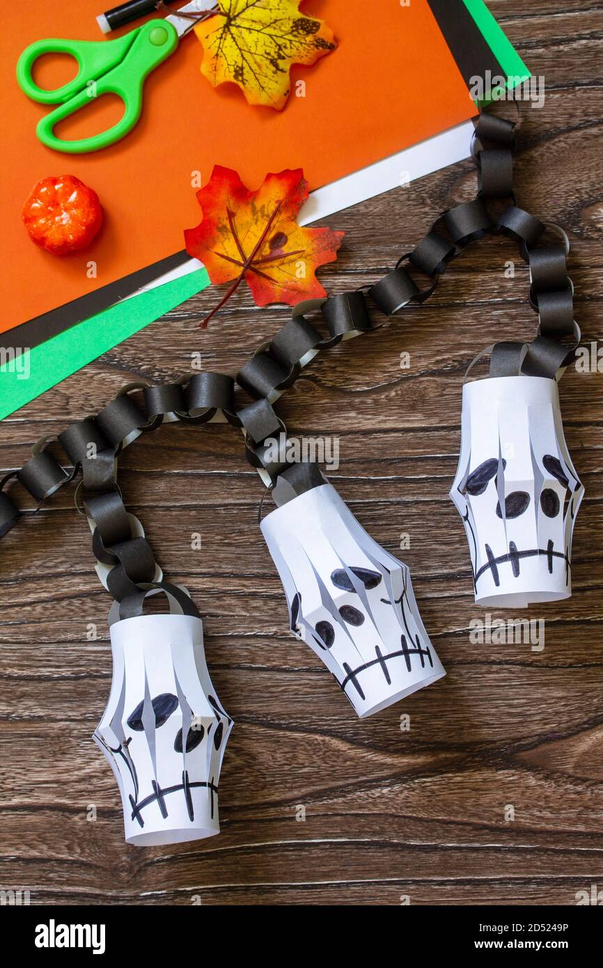 Halloween Room Decor Paper Lanterns Garland Skull For Halloween On A Wooden Table Childrens Art Project Crafts Fun Activities For Kids Stock Photo Alamy